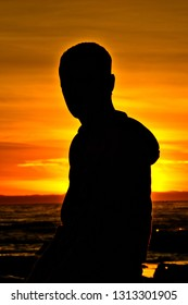 Silhouette of a man on the beach.