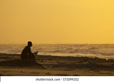 Silhouette of a man on a beach