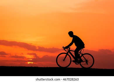 silhouette man on bicycle.concept of driving bicycle.