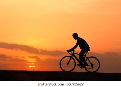 silhouette man on bicycle.concept of exercise.