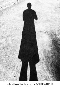 The silhouette of man on concrete floor