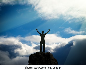 silhouette of man on huge clouds on a blue sky background.