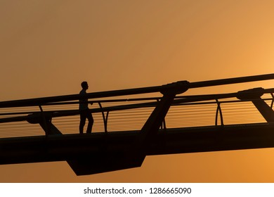 Silhouette of a man on Millenium Bridge in London, England, UK (07/23/2014)