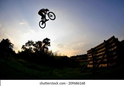 silhouette of a man on a mountain bike