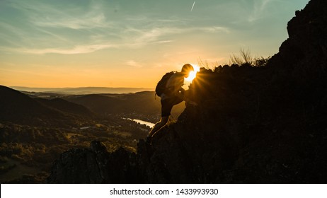 Silhouette of a man on a mountain top. Person on the rock. Sport and active life concept. Beauty world. Climber on rock face