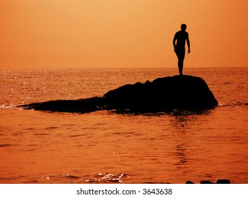A silhouette of a man on the reef, Sea of Japan