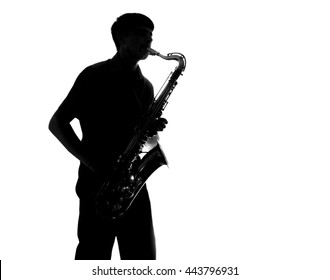 silhouette of a man playing the sax