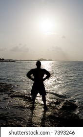 Silhouette of Man Posing Next to the Ocean