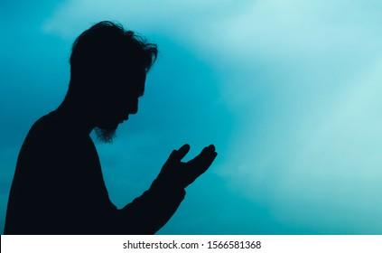 silhouette of a man praying (dua)