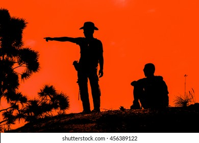 Silhouette of man resting after hiking and looking where he is.I