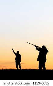 Silhouette of man with rifle aiming the hunt during a hunting party