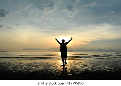 silhouette man running Background sunset on the sea