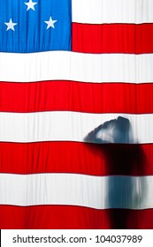 Silhouette of a man saluting the American flag