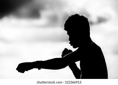 Silhouette of a man Show of strength  Muay Thai