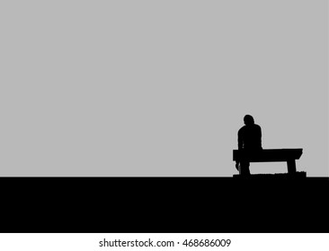 The silhouette of man sitting alone with grey sky, concept of lonely, sad, alone, person space/ single woman on valentine