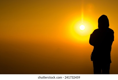 silhouette man standing on colorful sun light background