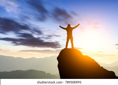 silhouette of man standing on the mountain,success concept scene