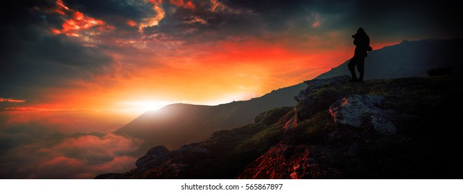 silhouette man standing on the peak of the mountains,  colorful foggy summer sunrise, Europe  mountains, Alps ,  photo exclusive on Shutterstock, wallpaper  background landscape
