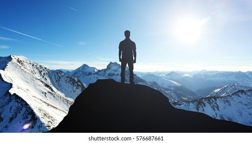 Silhouette Of A Man Standing On Top Of Mountain During Winter