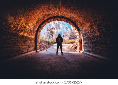 Silhouette of a Man Standing in a Tunnel, Central Park, NYC, USA
