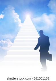 Silhouette of a man with suitcase step on to stairway leading up to bright light above the sky.