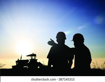 silhouette man survey and civil engineer stand on ground working in a land building site over Blurred construction worker on construction site. examination, inspection, survey