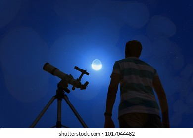 Silhouette of a man with telescope, Moon and stars.