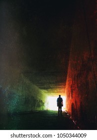 Silhouette of a man in a tunnel