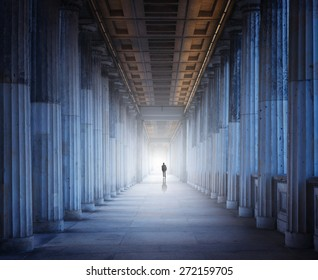 A silhouette of a man is walking into the light