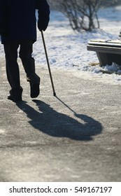 Silhouette of Man with Walking stick (cane) in a sunny winter morning