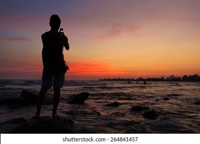 silhouette of a man what  do photo sunrise on phone