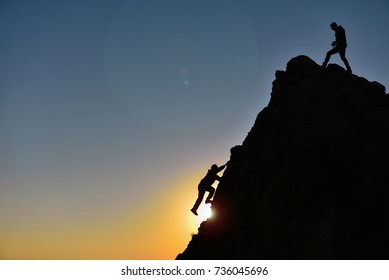 silhouette of the man who climbed the rocks