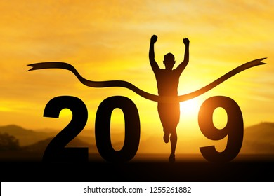 silhouette of Man Winner running  in 2019 text for happy new year concept