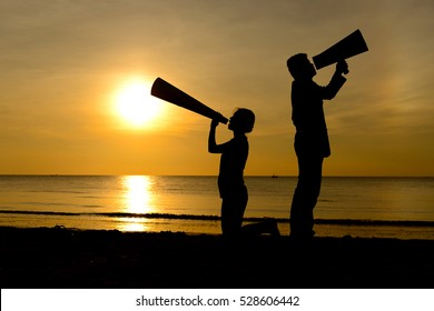 Silhouette man and woman with bullhorn megaphone advertisement concept