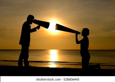 Silhouette man and woman with bullhorn megaphone argument concept