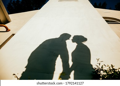 silhouette of a man and a woman, outdoors, shadows from people