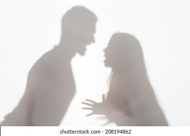 Silhouette of man and woman standing on white background and woman wanted to explain something gesticulating with her hands