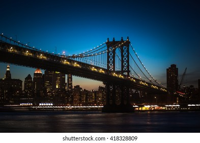 Silhouette of Manhattan Bridge and Manhattan Skyline at night