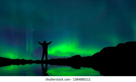 silhouette  men on  mountain and Aurora light  .success, winner, leader and Teamwork concept .