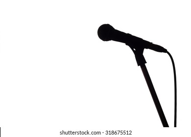 Silhouette of microphone on the white background with copy space.