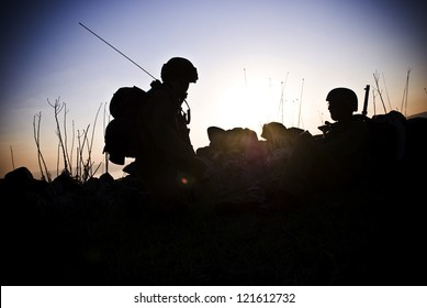 A silhouette of the military person on a background of a sunset