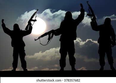 Silhouette of military soldier or officer with weapons at sunset. shot, holding gun, colorful sky, Concept of a terrorist. Silhouette terrorists with rifle at sunset