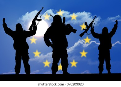 Silhouette of military soldier, shot, holding gun, colorful sky, Concept of a terrorist. Silhouette terrorists with rifle, national flag on background - European Union - EU