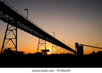 Silhouette of a mine shaft at sunset
