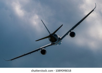 Silhouette of modern airplane turn during climbing