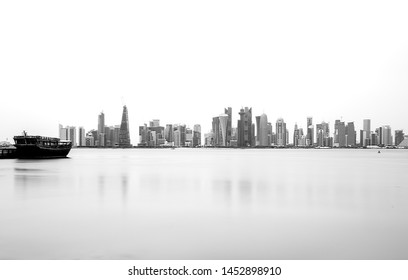 Silhouette of the  Modern Architectural Buildings of Doha skyline.