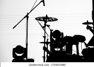 silhouette of a modern drum kit on stage on a white background