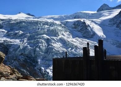 Silhouette of the Moiry Mountain Refuge in the Val d'Anniviers Switzerland, looking out over the Moiry Glacier Ice Fall