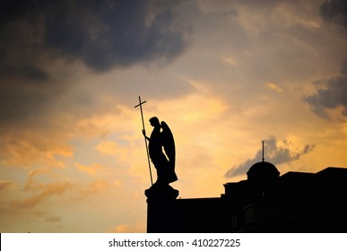 Silhouette of monument with angel on the top of it at sunset. Brest, Belarus