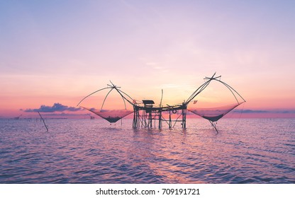 Silhouette Morning nature Sunrise ,Fish River Fishing Equipment at pra-pak  Phatthalung in Thailand.